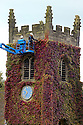 16/09/13 <br /> <br /> Estate workers give the virginia creeper its annual trim on the old parish church at Okeover, near Ashbourne, in the Derbyshire Peak district. All this year's new growth is pruned to protect the church's stonework and to stop the church disappearing altogether.<br /> <br /> <br /> All Rights Reserved - F Stop Press +44 (0) 1335 300098