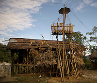 A funeral set up around a fresh grave of a tribal from Arunachal Pradesh. The Danyi Polo religion is followed and Shaman priests preside over the rituals.