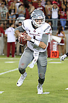 Luke Falk (4), Washington State quarterback, looks for running room during the Cougars Pac-12 Conference road victory over the Stanford Cardinal, 42-16, on October 8, 2016, at Stanford Stadium in Palo Alto, California.