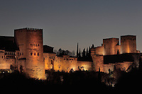 The Comares Tower (left), built in the 14th century under Muhammad V, the tallest tower in the Alhambra and housing the Hall of the Ambassadors, and right, the Alcazaba or defensive zone of the Alhambra Palace, Granada, Andalusia, Southern Spain. The Alhambra was begun in the 11th century as a castle, and in the 13th and 14th centuries served as the royal palace of the Nasrid sultans. The huge complex contains the Alcazaba, Nasrid palaces, gardens and Generalife. Picture by Manuel Cohen