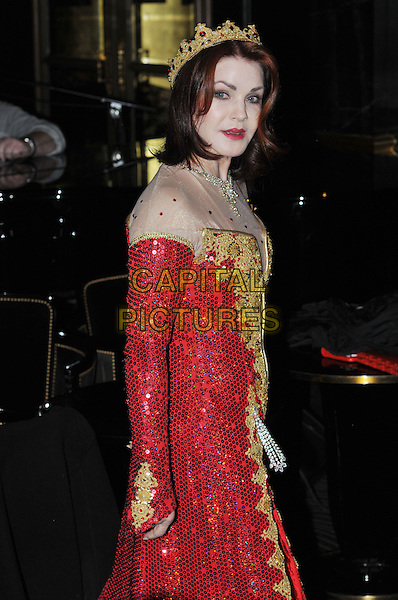 Priscilla Presley.Press launch to star in New Wimbledon Theatre's annual pantomime offering 'Snow White and the Seven Dwarfs' at The Savoy, Strand, London, England..September 26th, 2012.panto costume half length gold red dress crown sequins sequined side .CAP/BF.©Bob Fidgeon/Capital Pictures.