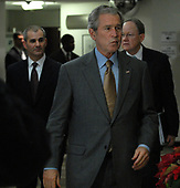 United States President George W. Bush arrives to speak to the media after visiting the Office of the Director of National Intelligence and the National Counterterrorism Center (NCTC) in McLean, Virginia, on December 8, 2008. With Bush is NTCT Director Mike Leiter (L) and  Director of National Intelligence Mike McConnell (R).  <br /> Credit: Roger L. Wollenberg / Pool via CNP
