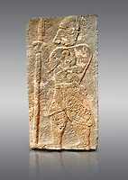 Pictures & images of the North Gate Hittite sculpture stele depicting a God with a spear. 8the century BC.  Karatepe Aslantas Open-Air Museum (Karatepe-Aslantaş Açık Hava Müzesi), Osmaniye Province, Turkey. Against grey background