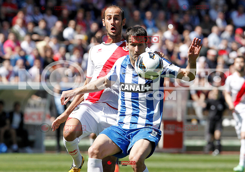 Rayo Vallecano's Alejandro Galvez (l) and Real Sociedad's Imanol Agirretxe during La Liga match.April 14,2013. (ALTERPHOTOS/Acero)