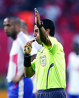 Referee Mr. Benito Archundia of Mexico starts the game. The Korea Republic and France played to a 1-1 tie in their FIFA World Cup Group G match at the Zentralstadion, Leipzig, Germany, June 18, 2006.