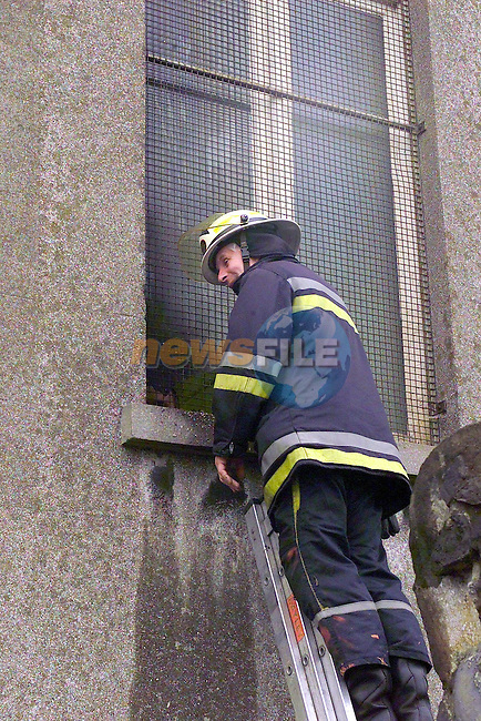 Fire officer looking at where the window of the District Court House bas broken and petrol was poured into the building in the Early hours of Friday Morning before the Drogheda District court was to sit. the District Court had to be adjurned because the Building was Smoke Damaged. Two Units fof the Drogheda uiire service were called to the scene...Picture Fran Caffrey Newsfile.