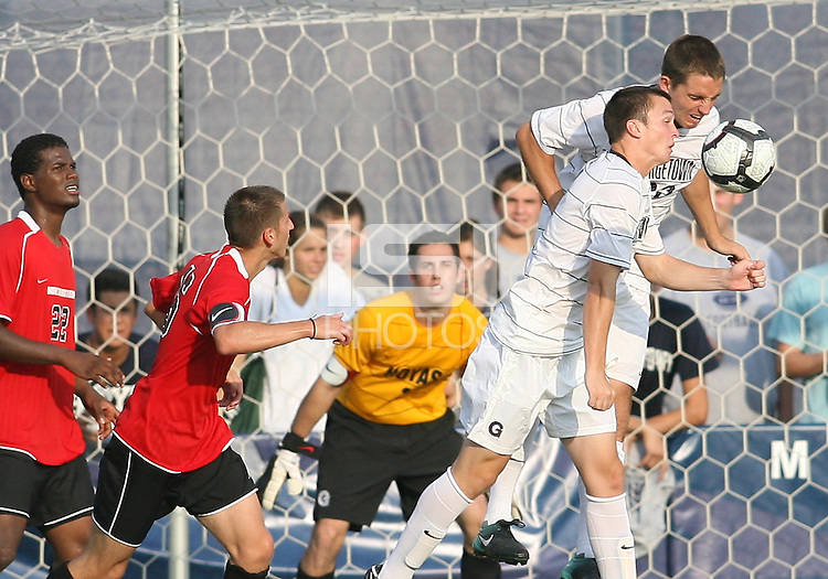 Joey Dillon #2 and Ben Slingerland #23 of Georgetown University clear the ball during an NCAA match against Northeastern University at North Kehoe Field, Georgetown University on September 3 2010 in Washington D.C. Georgetown won 2-1 AET.