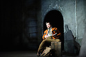 """English Touring Opera presents """"Don Giovanni"""", by Wolfgang Amadeus Mozart, at the Hackney Empire.  Directed by Lloyd Wood, with set & costume design by Anna Fleischle and lighting design by Guy Hoare. Picture shows:  Matthew Stiff (Leporello)."""