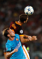 Calcio, Champions League, Gruppo E: Roma vs Barcellona. Roma, stadio Olimpico, 16 settembre 2015.<br /> FC Barcelona's Ivan Rakitic, left, and Roma's Edin Dzeko jump for the ball during a Champions League, Group E football match between Roma and FC Barcelona, at Rome's Olympic stadium, 16 September 2015.<br /> UPDATE IMAGES PRESS/Riccardo De Luca