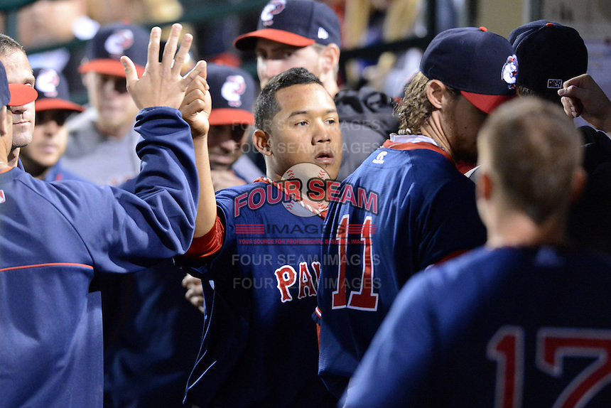 Pawtucket Red Sox shortstop Heiker Meneses (16) is congratulated after scoring the games first run during an International League playoff game against the Rochester Red Wings on September 5, 2013 at Frontier Field in Rochester, New York.  Pawtucket defeated Rochester 7-2.  (Mike Janes/Four Seam Images)