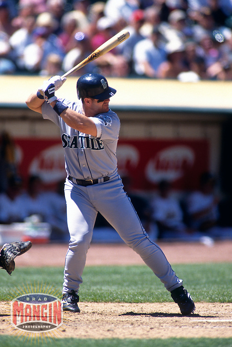 OAKLAND, CA -  Edgar Martinez of the Seattle Mariners in action during a game against the Oakland Athletics at the Oakland Coliseum in Oakland, California in 1997. Photo by Brad Mangin