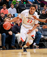 CHARLOTTESVILLE, VA- December 3: Malcolm Brogdon #22 of the Virginia Cavaliers handles the ball during the game on December 27, 2011 against the Longwood Lancers at the John Paul Jones Arena in Charlottesville, Virginia. Virginia defeated Longwood 86-53. (Photo by Andrew Shurtleff/Getty Images) *** Local Caption *** Malcolm Brogdon