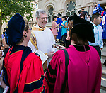 The Rev. Dennis H. Holtschneider, C.M., president of DePaul University, shares a laugh with faculty and staff members outside the Saint Vincent de Paul Parish Church on DePaul University's Lincoln Park Campus following the annual Baccalaureate Mass Friday, June 9, 2017. The event was part of the 119th commencement ceremonies for the Chicago university. (DePaul University/Jamie Moncrief)