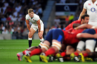Owen Farrell of England watches a scrum. QBE International match between England and France on August 15, 2015 at Twickenham Stadium in London, England. Photo by: Patrick Khachfe / Onside Images