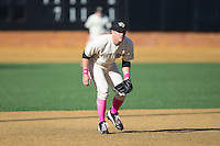 Wake Forest Demon Deacons third baseman Joe Napolitano (12) on defense against the Virginia Tech Hokies at Wake Forest Baseball Park on March 7, 2015 in Winston-Salem, North Carolina.  The Hokies defeated the Demon Deacons 12-7 in game one of a double-header.   (Brian Westerholt/Four Seam Images)