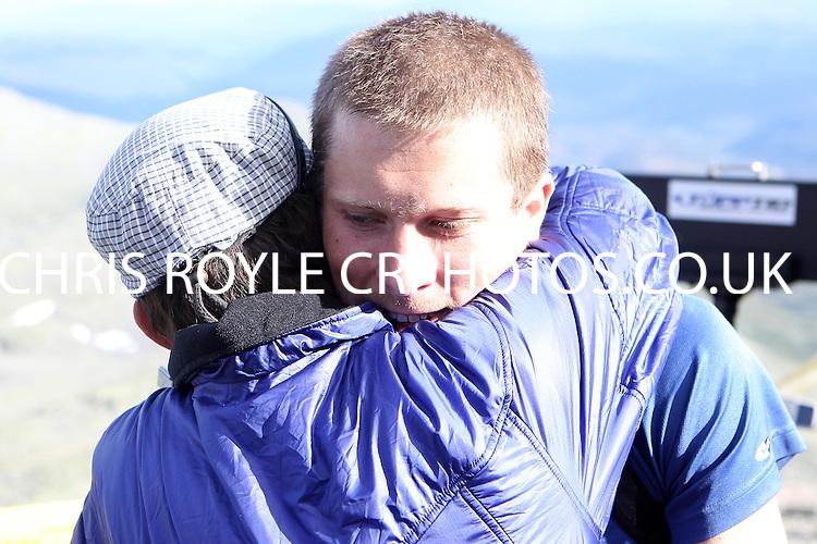 Race number 174 Henrik Bjoralt Roald - - Norseman Xtreme Tri 2012 - Norway - photo by chris royle/ boxingheaven@gmail.com