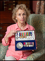 BNPS.co.uk (01202 558833)<br /> Pic: PhilYeomans/BNPS<br /> <br /> Demanding answers - Susan Bond, with some of her fathers medals she was shocked to find being sold by a London based medal dealer (the MC is a fake), and her grandfathers miniatures including a DSO and MC...the original gallantry medals for both have disappeared.<br /> <br /> Military museum in hot water over missing medals..<br /> <br /> A woman whose father and grandfather donated their highly-valuable gallantry medals to an army museum is furious they have disappeared having been suspiciously substituted for duplicates.<br /> <br /> Susan Bond, whose husband Richard is a retired crown court judge, discovered the two Military Cross groups at the The Royal Green Jackets Museum are not the ones bequeathed to them after one set appeared on the open market.<br /> <br /> Mrs Bond confronted the trustees at the museum, whose former Colonel-in-Chief was the Queen, but the 70-year-old has been left dismayed at their 'indifferent' response at the loss which they have been unable to properly explain.<br /> <br /> The owners - the museum based in Winchester, Hants - said they were satisfied that no criminal activity had taken place and the police investigation came to nothing.