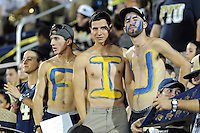 25 October 2011:  FIU fans, complete with body paint, watch their team in the third quarter as the FIU Golden Panthers defeated the Troy University Trojans, 23-20 in overtime, at FIU Stadium in Miami, Florida.