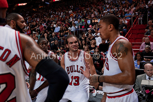 Miami, Florida<br /> January 29, 2012<br /> <br /> Chicago BULLS players, Joakim Noah, sitting, Derrick Rose (right) and Carlos Boozer (left) conferee during a time out against the Miami HEAT.