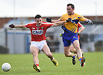 David Tubridy of Clare in action against Tom Clancy of Cork during their National Football League game at Cusack Park. Photograph by John Kelly.