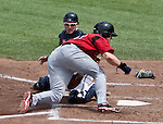 Reno Aces catcher Ryan Budde can't hang onto the ball as Albuquerque Isotopes Jerry Sands crashes into him at home plate during their game played on Sunday afternoon, August 12, 2012 in Reno, Nevada.