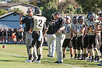 Palos Verdes, CA 09/27/13 - Michael Christensen (Peninsula Head Coach) and Larry Olson (Peninsula Coach) in action during the Lawndale vs Palos Verdes Peninsula Varsity football game at Peninsula High School.
