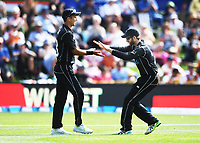 Trent Boult and Kane Williamson celebrate the wicket of Woakes.<br /> New Zealand Black Caps v England, ODI series, University Oval in Dunedin, New Zealand. Wednesday 7 March 2018. &copy; Copyright Photo: Andrew Cornaga / www.Photosport.nz