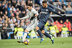Isco (l) of Real Madrid fights for the ball with Luis Munoz of Malaga CF during their La Liga 2016-17 match between Real Madrid and Malaga CF at the Estadio Santiago Bernabéu on 21 January 2017 in Madrid, Spain. Photo by Diego Gonzalez Souto / Power Sport Images