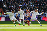 Real Madrid´s James Rodriguez and Luka Modric and Atletico de Madrid´s Filipe Luis during 2015/16 La Liga match between Real Madrid and Atletico de Madrid at Santiago Bernabeu stadium in Madrid, Spain. February 27, 2016. (ALTERPHOTOS/Victor Blanco)