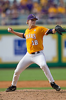 LSU Tigers pitcher Austin Bain (18) makes a pickoff throw to first base during the Southeastern Conference baseball game against the Texas A&M Aggies on April 25, 2015 at Alex Box Stadium in Baton Rouge, Louisiana. Texas A&M defeated LSU 6-2. (Andrew Woolley/Four Seam Images)