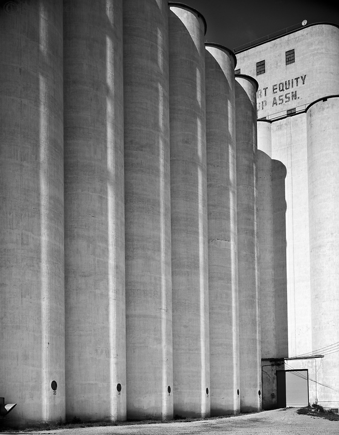 A group of silos rise high over the Great Plains holding its precious bounty.