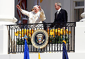 Pope Benedict XVI (L) waves as U.S. President George W. Bush (R) watches from a White House Balcony overlooking the South Lawn at the White House in Washington, D.C. USA on 16 April 2008. Today is the second day of the pope's visit to the United States.  Today is also  the 81st birthday of the pope.