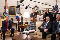 United States President Donald J. Trump answers a reporter's question as he meets Prime Minister Kyriakos Mitsotakis of Greece in the Oval Office of the White House in Washington, D.C. on Tuesday, January 7, 2020. Looking on from left to right are: first lady Melania Trump, US Secretary of State Mike Pompeo, and US National Security Advisor Robert C. O'Brien.<br /> Credit: Tasos Katopodis / Pool via CNP/AdMedia