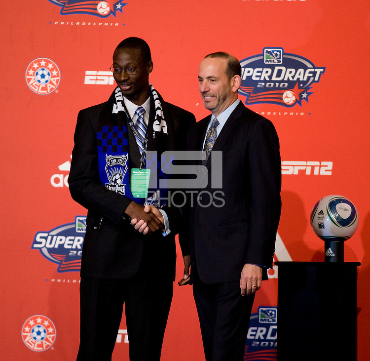 MLS commissioner Don Garber welcomes Ike Opara of Wake Forest to the stage as the third overall pick of  the MLS Superdraft by the San Jose Earthquakes at the Pennsylvania Convention Center in Philadelphia, PA.