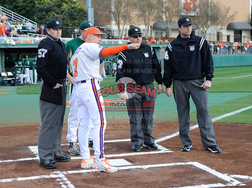 Head coach Jack Leggett of the Clemson Tigers goes over ground rules with umpires before a game against the William & Mary Tribe on Opening Day, Friday, February 15, 2013, at Doug Kingsmore Stadium in Clemson, South Carolina. Clemson won, 2-0. (Tom Priddy/Four Seam Images)