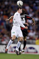 The Revolution's Jay Heaps goes up for a header with Ben Olsen of D.C. United. DC United defeated the New England Revolution 4 to 3 in a shoot out after overtime ended in a 3 all tie during the MLS Eastern Conference Championship at RFK Stadium, Washington, D.C., on Saturday, November 6, 2004..