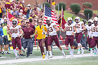 College Park, MD - September 22, 2018:  Minnesota Golden Gophers head coach P.J. Fleck runs on the field before the game between Minnesota and Maryland at  Capital One Field at Maryland Stadium in College Park, MD.  (Photo by Elliott Brown/Media Images International)