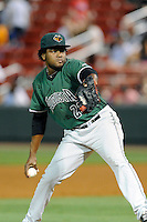 Pitcher Rodolfo Martinez (23) of the Augusta GreenJackets delivers a pitch in a game against the Greenville Drive on Thursday, June 11, 2015, at Fluor Field at the West End in Greenville, South Carolina. Greenville won, 10-1. (Tom Priddy/Four Seam Images)