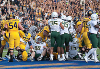 Shane Vereen scores the touchdown in a crowd. The Oregon Ducks defeated the California Golden Bears 15-13 at Memorial Stadium in Berkeley, California on November 13th, 2010