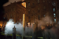 Crowds of visitors and Pratt Institute students and faculty welcome in the New Year, Tuesday, January 1, 2013 at the school's steam generating plant in Brooklyn in New York. Pratt Institute is the home of the oldest steam generators in the country which are used to heat the campus and run the school's co-generating plant. The power plant is a Mechanical Engineering Landmark. As unique as the plant is, what is more unique is that every New Year's Eve, the Chief Engineer Conrad Milster connects his collection of steam whistles, including the whistle from the USS Normandy and a steam calliope and sets them all off enveloping the crowd in a fog of steam and very LOUD noise. (© Frances M. Roberts)