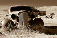 An abandoned car sits on the hills of the ghost town of Bodie nestled high in the Sierra