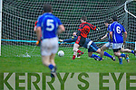 Kieran Courtney pounces on the loose ball to score Glenbeigh/Glencar winning goal against Laune Rangers captain Pa Sheahan during the Mid Kerry Championship final in Beaufort on Saturday