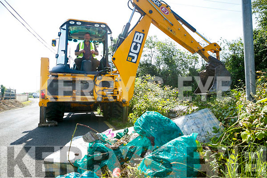 JCB had to be uses in cleaning up illegal dumping Dumping in Ballinorig. on Monday Pictured Litter Warden Brendan Murphy