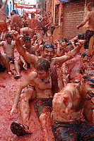BUNYOL, SPAIN - AUGUST 31: People immersed in tomato during the Tomatina August 31, 2005 in Bunyol, Valencia, Spain. Approximately 45,000 people pelted each other with a little over 100.000 kilograms of tomatoes. The tomatina is known as the world's largest tomato battle. Photo by Ander Gillenea