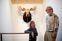 Los Angeles, California, November 14, 2009 - Portrait of Diane and Ernie Wolfe in the stairwell of their home. Behind them is a moose Ernie shot earlier this year during a hunting trip to Alaska. The Wolfe's own the Ernie Wolfe Gallery and are the most reknowned African at dealers in the country. ..CREDIT: Daryl Peveto/LUCEO for The Wall Street Journal.Homefront - Ernie Wolfe #1348.
