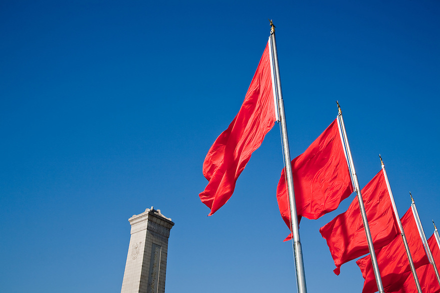 Monument to the people and red flags Beijing China