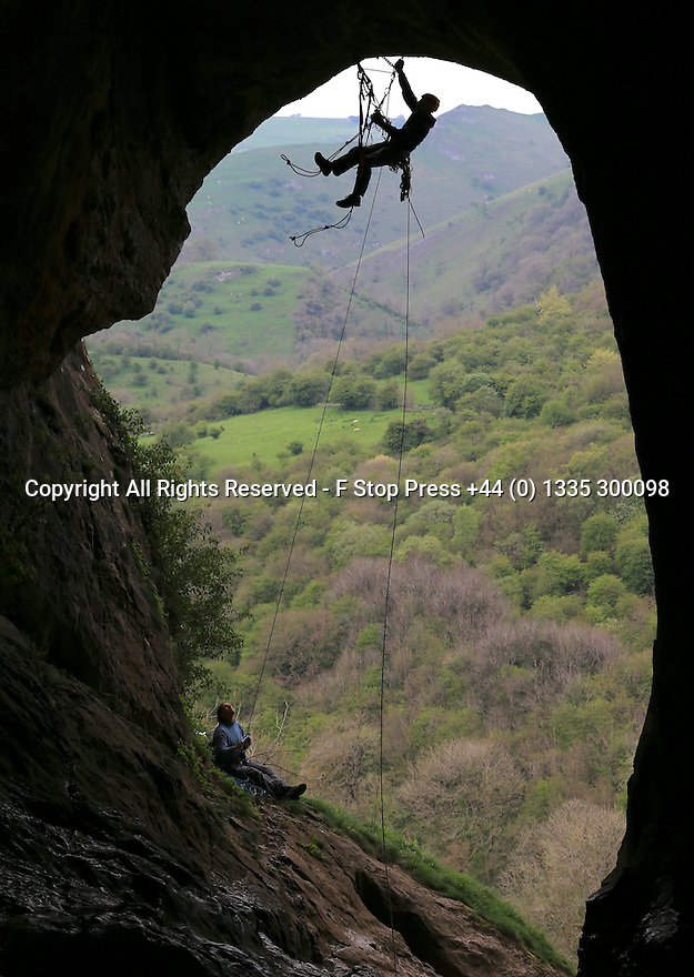 05/05/14<br /> <br /> Scott Anderson, 36, climbs one of Britain's longest roof climbs inside Thor's Cave in the Manifold Valley in the  White Peak area of The Peak District in Staffordshire. <br /> <br /> On average the challenging route is only climbed once every year.<br /> <br /> It took Scott, who spent the night in the cave, eleven hours to prepare and climb the 60 metre 'aid climb'  20 metres above the cave floor.<br /> <br /> Aid climbing is a style of climbing in which standing on or pulling oneself up via devices attached to fixed or placed protection is used to make upward progress.<br /> <br /> Thor's Cave is a natural cavern. Located in a steep limestone crag, the cave entrance, a symmetrical arch 7.5 metres wide , is prominently visible from the valley bottom, around 80 metres (260 feet) below.<br /> <br /> Thor's Cave has been used by rock climbers since the early 1950s.<br /> <br /> Excavations in 1864–65 and 1927–35 found human and animal remains, stone tools, pottery, amber beads, and bronze items within Thor's Cave and the adjacent Thor's Fissure Cavern. The caves are estimated to have contained the burial sites of at least seven people.[1] The finds suggest the cavern was occupied from the end of the Palaeolithic period, with more intensive use during the iron age and Roman periods.<br /> <br /> <br /> All Rights Reserved - F Stop Press +44 (0) 1335 300098