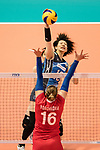 Middle blocker Mai Okumura of Japan (C) spikes the ball during the FIVB Volleyball World Grand Prix match between Japan vs Russia on 23 July 2017 in Hong Kong, China. Photo by Marcio Rodrigo Machado / Power Sport Images