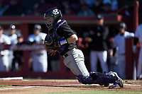 Holy Cross Crusaders catcher Riley Livingston (23) blocks a throw at home plate during the game against the South Carolina Gamecocks at Founders Park on February 15, 2020 in Columbia, South Carolina. The Gamecocks defeated the Crusaders 9-4.  (Brian Westerholt/Four Seam Images)