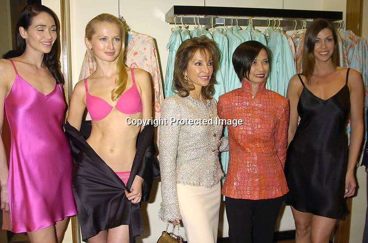Susan Lucci and Josie Natori and models wearing Natori ..at a party at Saks Fifth Avenue hosted by  Josie Natori and ..Susan Lucci to help raise awareness and funds for Women in Need on April 28, 2005. Women in Need is an organization that serves women and children who are homeless and disadvantaged. A portion of the  sales from the Natori collection will go to Women in Need...Photo by Robin Platzer, Twin Images..